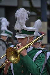 Trombonist In The Drizzling Rain (Scott 97006) Tags: music trombone marching band uniform parade hat plume drizzle rain