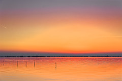 Last Plane To The Sun (Alfred Grupstra) Tags: sunset nature sky dusk sun landscape reflection sunrisedawn sunlight sea lake orangecolor water outdoors summer scenics dawn morning tranquilscene beautyinnature