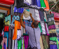 A man selling clothes (phuong.sg@gmail.com) Tags: asia blue buy cloth clothes clothing color cotton delhi department design designer display fabric fashion green hanger india male manufactured market men pattern polyester quality rack range retail rich row sale select sell shirt shop show showroom silk store striped textile variety wardrobe wear