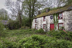 Miss Jones Remembers… (Ffotograffiaeth Dylan Arnold Photography) Tags: house derelict abandoned overgrown garden nature green red white door reddoor whitehouse dilapidated tranquil peaceful calm quiet history time ghosts past broken wild neglected brambles trees oldcars wrecks farmhouse old