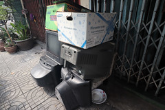 TVs and boxes left outside a house (_gem_) Tags: trip vacation holiday bangkok thailand city street urban found foundobjects tv box boxes television streettableau