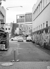 street (Pavel Vrzala) Tags: australia australie canberra 2015 2014 olympus pen ft penft blackandwhite bw 35mm halfframe film act city civic citycentre analog analogue analogphotography filmphotography filmcamera blackwhite blackandwhitephoto backlane kodak kodaktmax100 tmax100