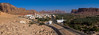 Elevated view of al-ula old town and oasis, Al Madinah Province, Al-Ula, Saudi Arabia (Eric Lafforgue) Tags: above adobe adobehouse aerialview alula alulah ancient ancienttown arabia arabianpeninsula building colourimage dedan environment ghosttown gulfcountries hill horizontal house ksa ksa0910panorama landscape lihyanites middleeast mountain nature nopeople oasis oldtown outdoors panorama red ruin saudiarabia scenics tourism travel valley