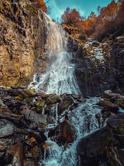golden waterfall (Leona Gorden) Tags: landscape outdoor serene autumn foothill leaves mountains texture folk hike leonagorden stones haze walk view nobody travel trees colorful nature beauty natural valley high leisure slopes mountain background tranquil photography photo dusk road yellow moss gold adventure dombay kchr alania russia climbing woods tree plant grass sky snow field mountainside forest