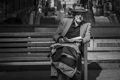 Enigma (Leanne Boulton) Tags: urban street candid portrait streetphotography candidstreetphotography candidportrait streetlife man male old elderly face expression sitting bench crossword puzzle thinking pattern hat sunlight tone texture detail depthoffield bokeh naturallight outdoor light shade shadow city scene human life living humanity society culture lifestyle people canon canon5d 5dmkiii 70mm ef2470mmf28liiusm black white blackwhite bw mono blackandwhite monochrome glasgow scotland uk