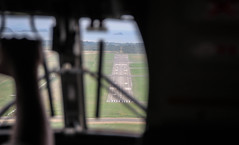 Port Moresby Runway (Andy.Gocher) Tags: aeroplaneseat andygocher canon100d sigma18250 canon100dsigma18250 png papuanewguinea portmoresby flying windowseat aeroplanewindow aerial airport runway twin otter aviation aircraft