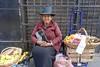 Street vendor, Centro Historico, Lima (Yekkes) Tags: lima peru centrohistorico latinamerica woman elderly respectable bible religious pious belief certainty tradition hat saleswoman vendor street urban city fruit baskets