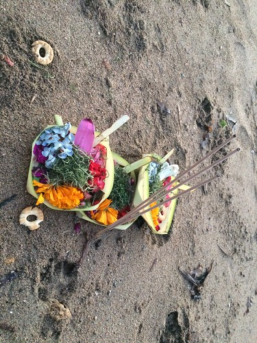 Hindu tradition to give flowers to god in the beach of Bali