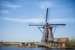 A windmill has arms, but does not hug. Where's the love? (Peter Jaspers (back in july)) Tags: frompeterj© 2018 olympus zuiko omd em10 1240mm28 kinderdijk mill water holland landscape dutchlandscape hollandslandschap unesco heritage worldheritage molenwaard
