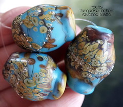Rocks Turquoise Ocher Silvered Matte (Laura Blanck Openstudio) Tags: openstudio openstudiobeads glass murano handmade lampwork set beads jewelry rocks pebbles stones etched matte glow glowing opaque frosted whimsical funky odd made usa colorful multicolor abstract asymmetric bold erthy organic fine arts art artist artisan artistic nuggets turquoise aqua blue raku ocher sterling silver silvered maroon burgundy wine bordeaux honey brown suede mustard earthy