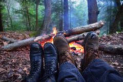 Boots By The Fire (jna.rose) Tags: boots fire camping campfire outdoor photography nikon camp wood woods trees leaves nature outdoors laces shoes burn burning hot warm sitting girl boy spring seasons blue jeans black brown log logs