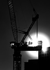 Winter And Construction (thelearningcurvedotca) Tags: briancarson canada canadian ontario thelearningcurvephotography toronto abstract architecture background blackandwhite bnw building city construction crane design development downtown environment equipment exterior geometric industrial industry light lines machine machinery minimal modern monochrome outdoors pattern perspective photography silhouette site skyscraper steel street structure sun sunlight texture tower urban wall window work working absolutearchitecture awardflickrbest bwartaward bwmaniacv2 bej blackwhitephotos blackandwhiteonly blogtophoto bwemotions cans2s discoveryphotos iamcanadian linescurves noiretblanc torontoist true2bw yourphototips