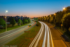 Traffic light trails - DSC_6508 (John Hickey - fotosbyjohnh) Tags: 2018 cabinteely may2018 trafficlighttrails lighttrails landscape lights sky bluehour dusk longexposure trees roadway road n11