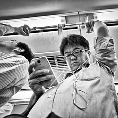fujisawa, japan (michaelalvis) Tags: asia bw blackandwhite candid city citylife cellphones fujifilm fujisawa japan japanese japon monochrome nihon nippon kamakura peoplestreet portrait people peoplestreets travel train urban x70