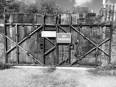 "Junkyard gates. (Bennydorm) Tags: yards yard grim rough entrance opening access towpath boundary barrier inghilterra inglaterra angleterre europe uk gb britain england cumbria furness ulverston dark noir may ""noparking"" scruffy old gates scrapyard junkyard"
