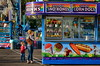 Get A Big One, Mommy (MPnormaleye) Tags: snacks candy soda treats carnival midway fair circus signs sunset dusk child boy kid mother telephoto