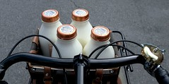 Dairy Weekly Loot (Shu-Sin) Tags: milk ronny brooks bottle bottles bicycle front handlebars porteur bag fuji white glass ny