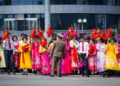 Waiting for the parade, DPRK (TeunJanssen) Tags: military parade pyongyang northkorea dprk ypt youngpioneertours asia korea flowers dressedup waving olympus omd omdem10 backpacking travel traveling worldtravel worldtrip people celebration kimilsung dayofthesun anniversary