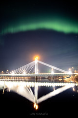 Bridge of lights (janiylinampa) Tags: northernlights auroraborealis aurora auroras revontulet nordlicht polarlicht nordlys norrsken rovaniemi lapland finland lappi suomi laponie laponia lappland finnland white green blue stars nightphotography bridge jätkänkynttilä river reflections lights