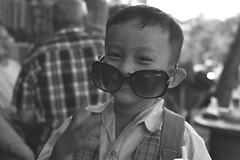 Cool kid (hasor) Tags: siem reap cambodia southeastasia kid child khmer sunglasses happy portrait monochrome boy playful smiling