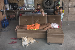 Just hanging around (Photosightfaces) Tags: kid dog boys boy flip flop lying asleep philippines dumaguete couch sofa covered