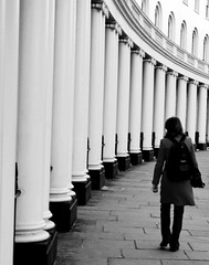 DSC09826 (stephenjenkins25) Tags: black white street photography candid portrait woman walking sweeping curve columns building