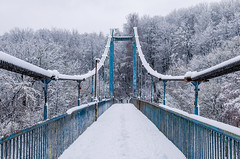 Cable-stayed old bridge covered with snow. Blue bridge in winter (ivan_volchek) Tags: bridge suspension architecture sky travel river gate water city landmark blue road suspensionbridge transportation cable sunset landscape winter fence cold wood snow nature outdoors barrier traveling visiting instatravel instago construction wooden wire steel