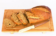 Rye bread with cereals on wooden table. Isolated (yannamelissa) Tags: bread rye cereal dark closeup fresh wooden flour brown food background white healthy natural table breakfast organic diet meal loaf grain wheat whole crust rustic homemade black wood gourmet tasty agriculture eating product seed board french pastry bakery corn bake baker texture home warm aromatic knife tray dinner isolated