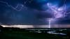 Burza nad Burzynem (mirosławkról) Tags: poland biebrza burzyn water sky clouds sundown thunder lightning rain river storm nikonnaturephotography