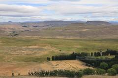 near Estancia La Negra (blauepics) Tags: argentina argentinien patagonia patagonien landscape landschaft hills hügel mountains berge neuquén province provinz provincia clouds wolken scenery plains ebene estancia la negra agriculture landwirtschaft farm
