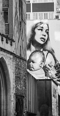 Mother and Son and the arch monochrome (PDKImages) Tags: bristol bristolstreetart streetart art urban buildings architechture city scene mural urbanart windows mother child motherandchild love motherhood