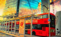 London Bridge Bus Station (M C Smith) Tags: crane reflection londonbridge london buildings bus buses route 43 red busshelter signs letters numbers symbols yellow lines bollards chrome lamp silver blue