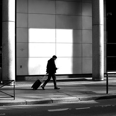 In front of the light (pascalcolin1) Tags: paris13 homme man lumière light valise suitcase fenêtre window photoderue streetview urbanarte noiretblanc blackandwhite photopascalcolin 5omm canon50mm canon