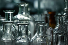 Peaking in the cabinet (hey ~ it's me lea) Tags: bottles pharmacy vintage antiques glass light lit breakable beverycareful