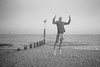 (Attila Pasek) Tags: 35mm argusc3 kodak plusx analogue bw beach blackandwhite film groyne guy jump man rangefinder