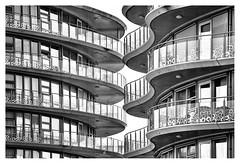 Kissing balconies (leo.roos) Tags: architecture architectuur balconies doors windows careynwoerdblok schiereiland woerdblokeiland noiretblanc naaldwijk westland meyerorestor13528 1969 m42 zebra a7rii day135 dayprime dayprime2018 dyxum challenge prime primes lens lenzen brandpuntsafstand focallength fl darosa leoroos