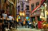 Lyon Restaurants (szeke) Tags: lyon bellecour france street pedestrian sidewalkcafe restaurant people cafe commerce cobblestone streetlights flags