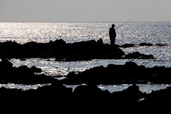 Puako fisherman (mfeingol) Tags: sunset bigisland ocean silhouette evening hawaii fisherman waimea unitedstates us