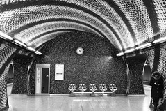Checking The Time (tcees) Tags: szentgellérttér undergroundstation m4 woman clock tiles wall platform sign chairs patterns budapest hungary urban x100 fujifilm finepix bw mono monochrome blackandwhite streetphotography street buda