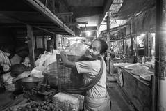 (kuuan) Tags: indonesia voigtländerheliarf4515mm manualfocus mf voigtländer15mm aspherical f4515mm superwideheliar apsc sonynex5n portrait solo surakarta street java market bazaar pasar pasarlegi stall woman carry marketstall eyes eyecontact