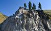 Roadside Bluff (maytag97) Tags: maytag97 nikon d750 outdoor outside rock stone bluff fence bolt sunny sunshine shadow contrast tree conifer evergreen blue sky