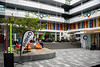 Having Lunch (Jocey K) Tags: newzealand nikond750 building architecture signs flags trees beanbags christmasdecorations cafe people shops cbd earthquakerebuild christchurch