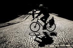 Forward (MortenTellefsen) Tags: forward bw blackandwhite monochrome bicycle walk cobblestone bergen norway norwegian norsk norge sykkel brostein skygge shadow shadows