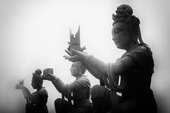 Three goddesses (mirsavio) Tags: china hong kong greatbuddha mist statues blackandwhite fuji xt