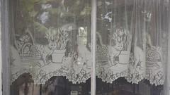 Cat curtains | Hemmingway House (Kaemattson) Tags: theernesthemingwayhomeandmuseum hemingway house key west florida keys tropical garden cat curtains