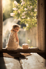 Ania (blossom) (iwona_podlasinska) Tags: girl hat frame wooden door blossom light backlit magical iwona podlasinska