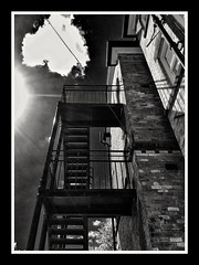 Sunny Fire Escape (Develew) Tags: northerngeneralhospital sheffield fireescape sun sunlight brightlight bw monochrome england whiteandblack up southyorkshire