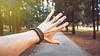 Touch (jonas.svidras) Tags: bracelet hand trees forest pavement wallpaper motivation inspiration hustle cloudsanddirt fhd 4k 5k fullhd highresolution royaltyfree stockphoto