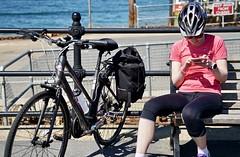 PinkyBlinder (Hodd1350) Tags: sandbanks poole dorset bicycle helmet bench smartphone sign sitting railings paniers sony sonyfe70300 a7rlll
