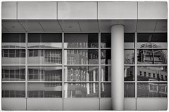 windows & reflections #2 (fhenkemeyer) Tags: canoneos70d niksilverefexpro2 bw hww windows facade architecture reflection netherlands denhaag